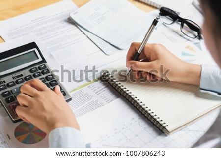 accountant using calculator calculate budget finance stock photo