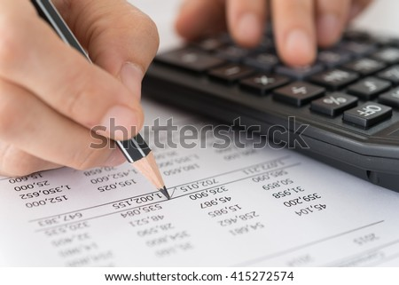 Accountant verify the accuracy of financial statements. Bookkeeping, Accountancy Concept. - stock photo