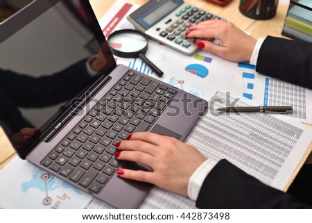 accountant woman considers on the laptop profit