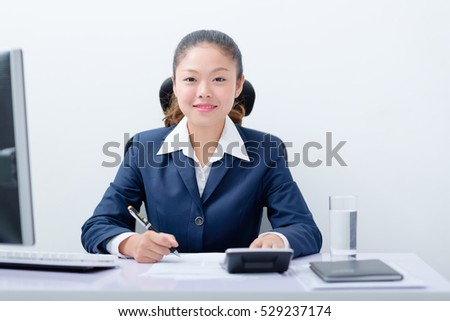 Accountant working at desk.