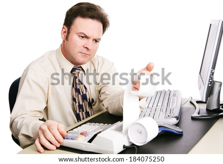 Accountant working on finances and looking serious.  White background.   - stock photo