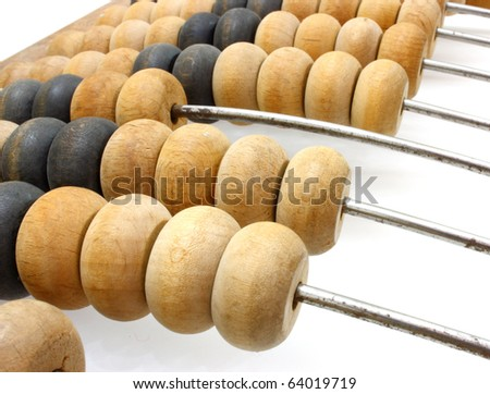 Accounting abacus for financial calculations lies on a white background - stock photo