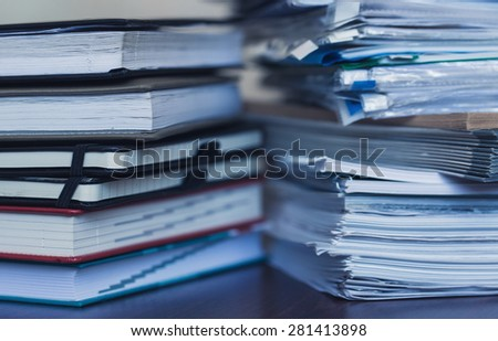 Accounting and taxes. Large pile of magazine and books closeup - stock photo