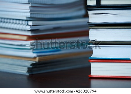 Accounting and taxes. Large pile of magazine, notebook and books closeup