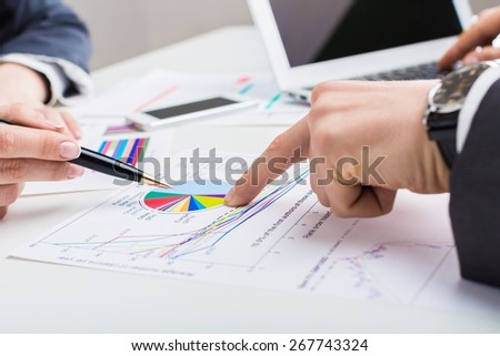 Accounting. Business people discussing during a meeting - stock photo
