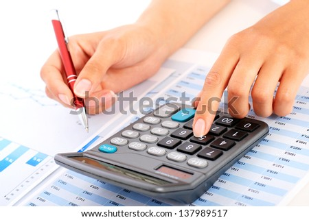 Accounting concept. Hands, pen and calculator.