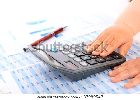 Accounting concept. Kid hands and calculator.