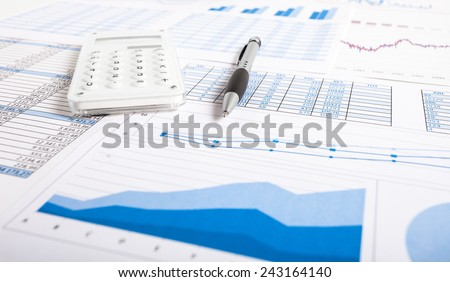 Accounting concept: pen, calculator and paperwork - stock photo