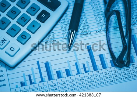 Accounting financial bank banking account stock spreadsheet data with glasses pen and calculator in blue financial concept