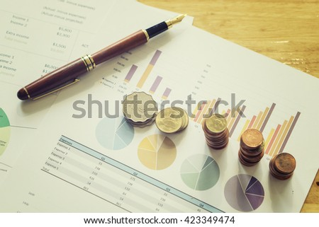 accounting,financial,Saving money concept,graph, stacks of coins ,chart and pen ,copy spacemoney concept,vintage,selective focus - stock photo