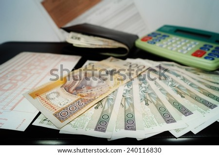 Accounting for taxes in poland - Money advance return for polish tax - stock photo