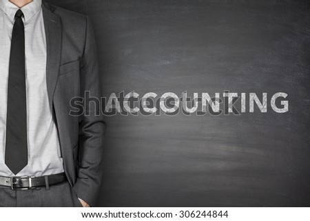 Accounting on black blackboard with businessman on side - stock photo