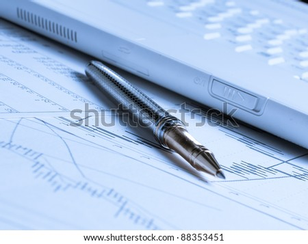 Accounting with pen and laptop on the table