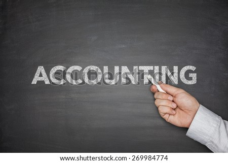 Accounting word on black blackboard with businessman hand - stock photo