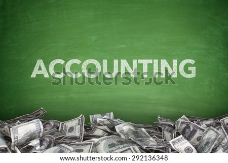 Accounting word on green blackboard with pile of dollars - stock photo
