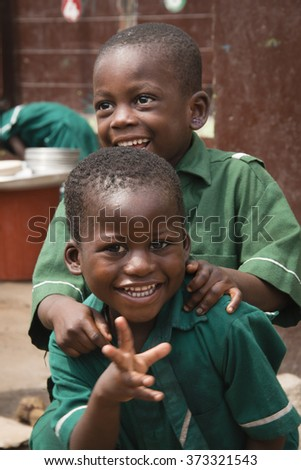 ACCRA, GHANA - JANUARY 2016: School children in front of their school in Jamestown, Accra, Ghana