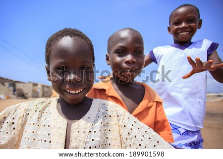 ACCRA, GHANA - MARCH 18: Unidentified African boys greeting to tourists with smiling faces  on March 18, 2014 in Teshie community, Accra, Ghana. Teshie is the famous fishing community in Ghana.