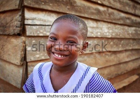 ACCRA, GHANA - MARCH 18: Unidentified African girl pose with smiling face to tourists on March 18, 2014 in Accra, Ghana. Ghana is one of most popular tourists destination in Africa.