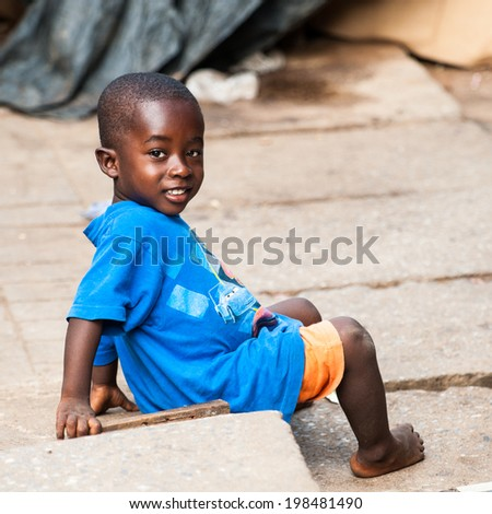 ACCRA, GHANA - MARCH 4, 2012: Unidentified Ghanaian boy in the street in Ghana. Children of Ghana suffer of poverty due to the unstable economic situation