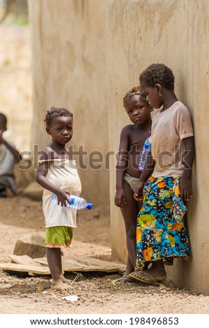 ACCRA, GHANA - MARCH 6, 2012: Unidentified Ghanaian children  in the street in Ghana. Children of Ghana suffer of poverty due to the unstable economic situation