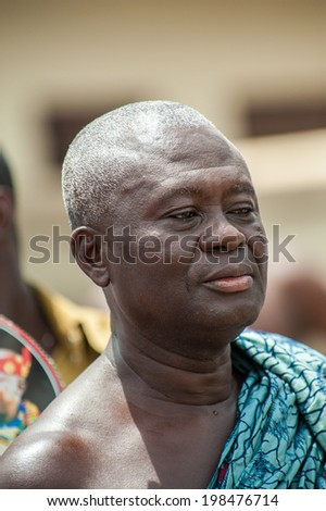 ACCRA, GHANA - MARCH 4, 2012: Unidentified Ghanaian man in clothes for special occasions in Ghana. People of Ghana suffer of poverty due to the unstable economic situation