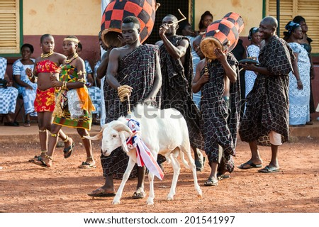 ACCRA, GHANA - MARCH 4, 2012: Unidentified Ghanaian man makes a performence with a goat in Ghana. People of Ghana suffer of poverty due to the unstable economic situation