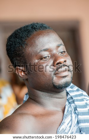 ACCRA, GHANA - MARCH 4, 2012: Unidentified Ghanaian man portrait in Ghana. People of Ghana suffer of poverty due to the unstable economic situation