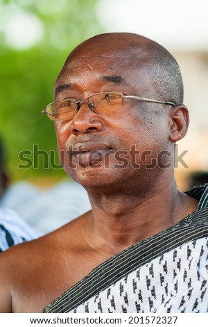 ACCRA, GHANA - MARCH 4, 2012: Unidentified Ghanaian man portrait in the street in Ghana. People of Ghana suffer of poverty due to the unstable economic situation