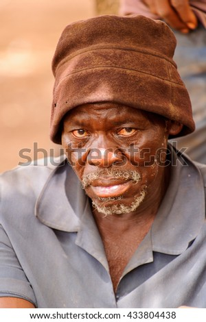 ACCRA, GHANA - MARCH 6, 2012: Unidentified Ghanaian old man looks seriously in the street in Ghana. People of Ghana suffer of poverty due to the unstable economic situation