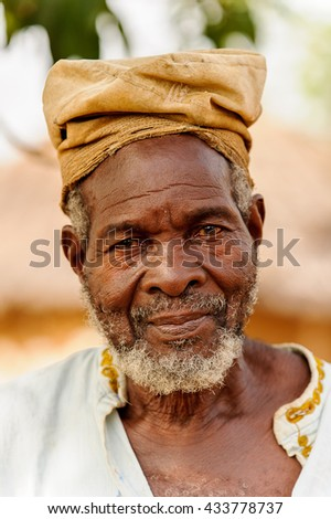 ACCRA, GHANA - MARCH 6, 2012: Unidentified Ghanaian old man with a hat in the street in Ghana. People of Ghana suffer of poverty due to the unstable economic situation