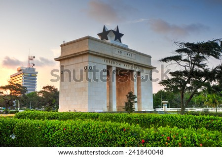 "ACCRA, GHANA - NOVEMBER 14, 2011: The Independence Arch of Independence Square of Accra at sunset. Inscribed with the words ""Freedom and Justice, AD 1957"", commemorates the independence of Ghana. - stock photo"