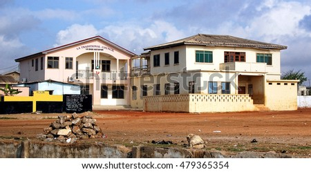 Accra. Ghana - September 17, 2013: Urban view of a street with the old houses in developing countries of West Africa.