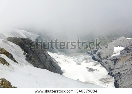 Accumulation of snow on the slope of Monch and Jungfrau mountain - stock photo