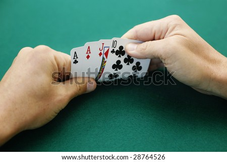 Ace Ace Jack Ten Double Suited. Premium starting hand in Omaha High Low poker.