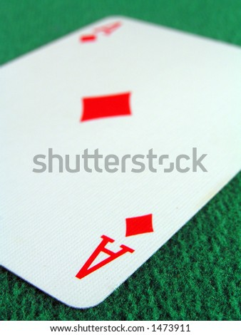 Ace of diamonds on a green felt table top.