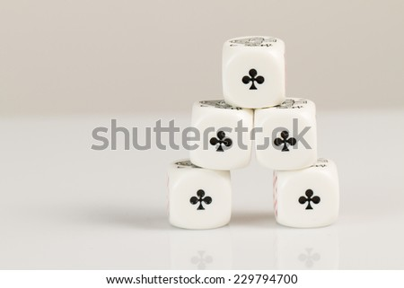 Aces Playing poker dice closeup on white background reflective pyramid - stock photo