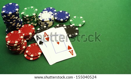 Aces - poker hand in front of chips - stock photo