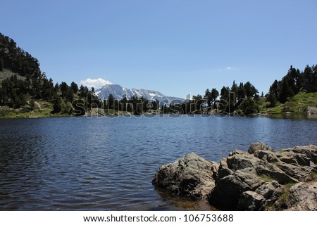 Achard Lake in alpine Belledonne massif, Chamrousse ski center, near Grenoble city, France. - stock photo