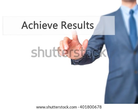 ACHIEVE RESULTS - Businessman hand pressing button on touch screen interface. Business, technology, internet concept. Stock Photo