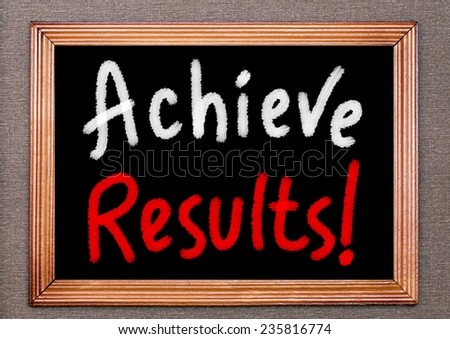 Achieve results! handwritten on a chalkboard. Business or Education Concept - stock photo