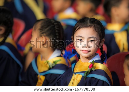Achievement of degree for young babay in the meeting room - stock photo