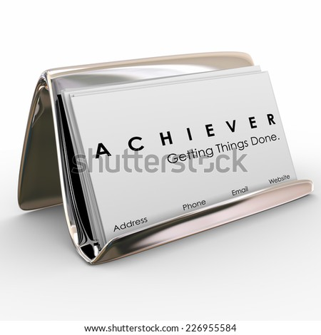 Achiever word on business cards in a holder to promote your expertise and ability to get things done in job, career or life - stock photo