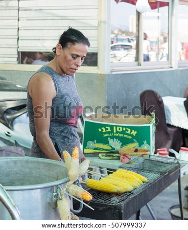 Aco, Israel, October 22, 2016: Street vendor sells boiled corn on the waterfront in Aco, Israel