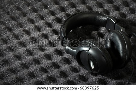 Acoustic foam wall and headphone - stock photo