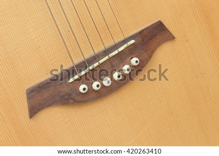 Acoustic guitar body music instrument detail on white background