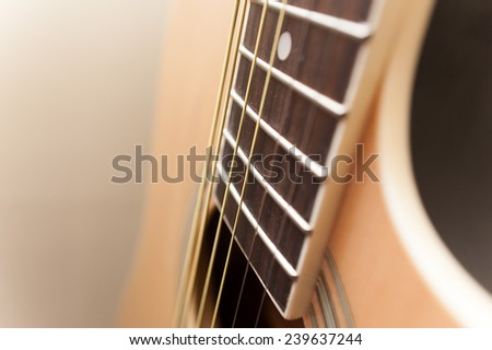 Acoustic guitar close-up. selective focus image - stock photo