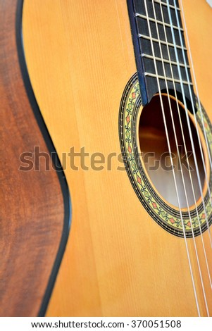 Acoustic guitar closeup view - stock photo