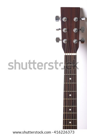 Acoustic guitar headstock on white background.