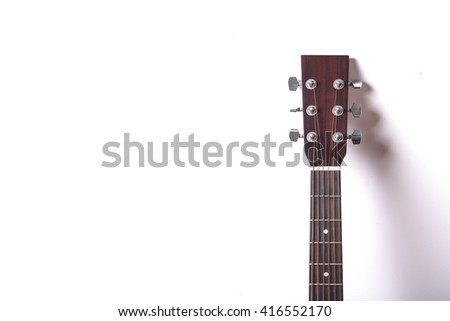 Acoustic guitar headstock on white background. - stock photo