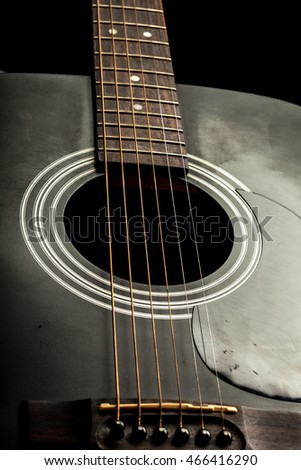 Acoustic Guitar in black and white the music room